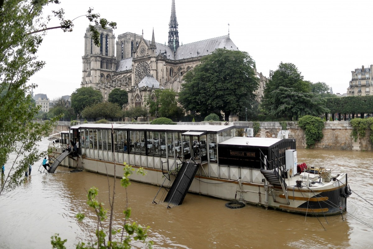 General view of the flooded river-side of the River Seine in central Paris with the Notre-Dame Cathedral in the background.