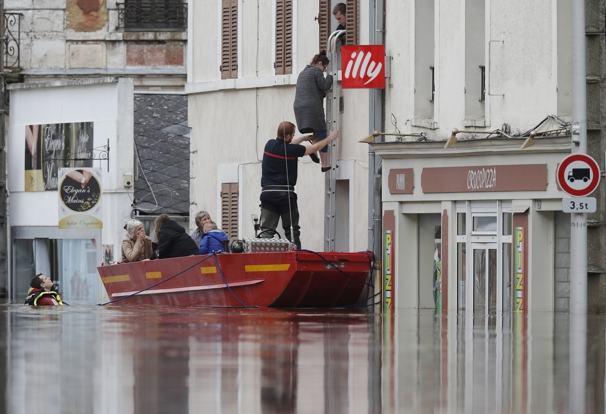 French firefighters use a small boat to evacuate residents in Montargis, near Orleans.