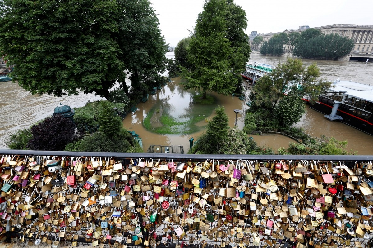 Padlocks clipped by lovers are seen in front of the