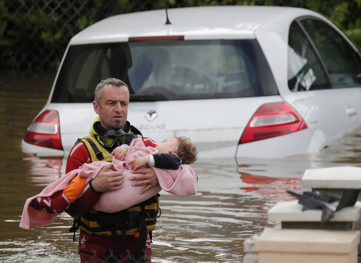A French firefighter evacuates a baby from a flooded area in Chalette-sur-Loing, near Orleans, France.