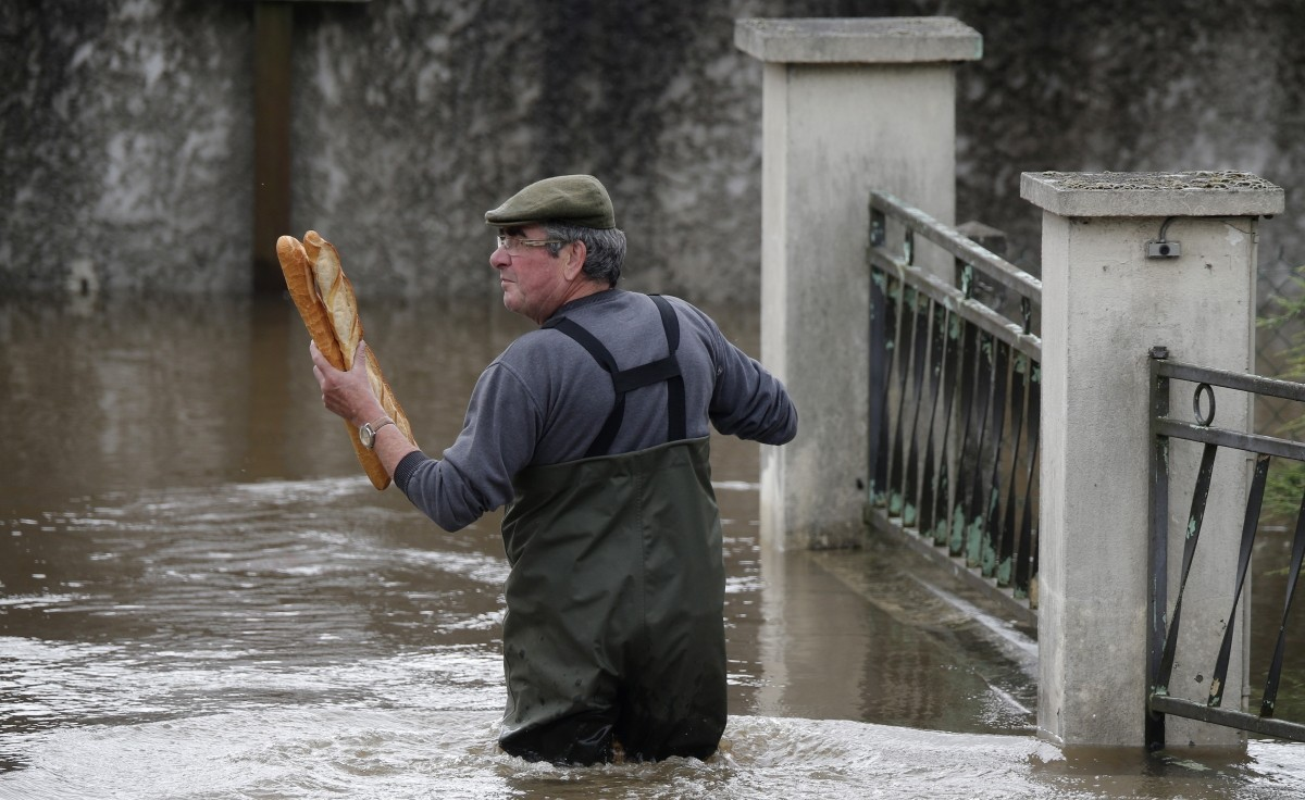 A resident brings French baguettes to his mother's flooded house in Chalette-sur-Loing Montargis, near Orleans, France.