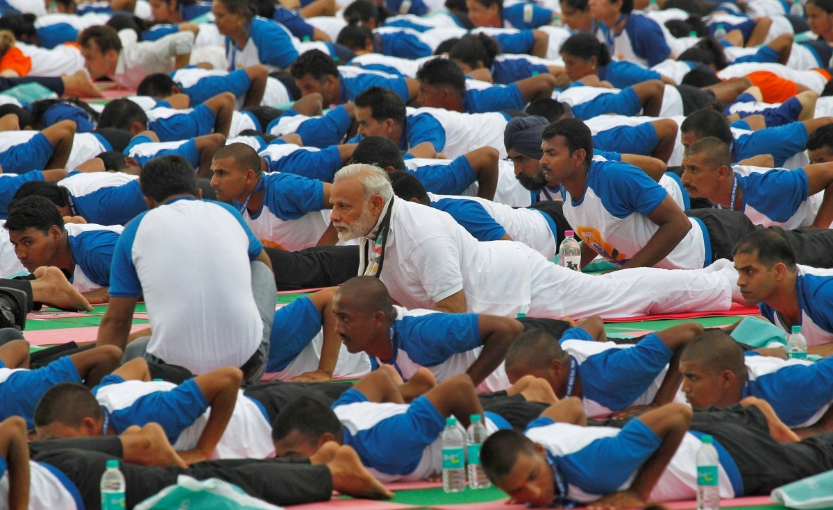 India's Prime Minister Narendra Modi (C) performs yoga during World Yoga Day in Chandigarh, India, June 21, 2016.