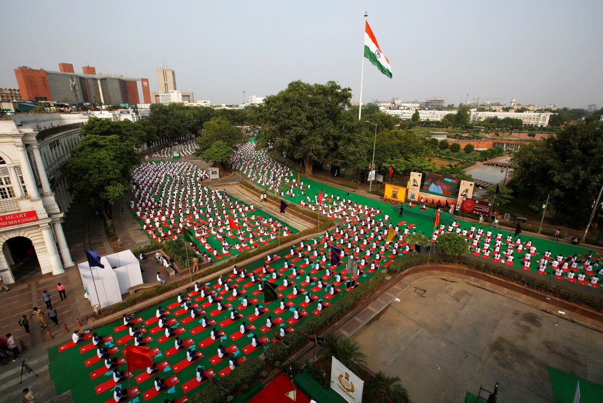 Participants perform yoga during World Yoga Day in New Delhi, India, June 21, 2016.