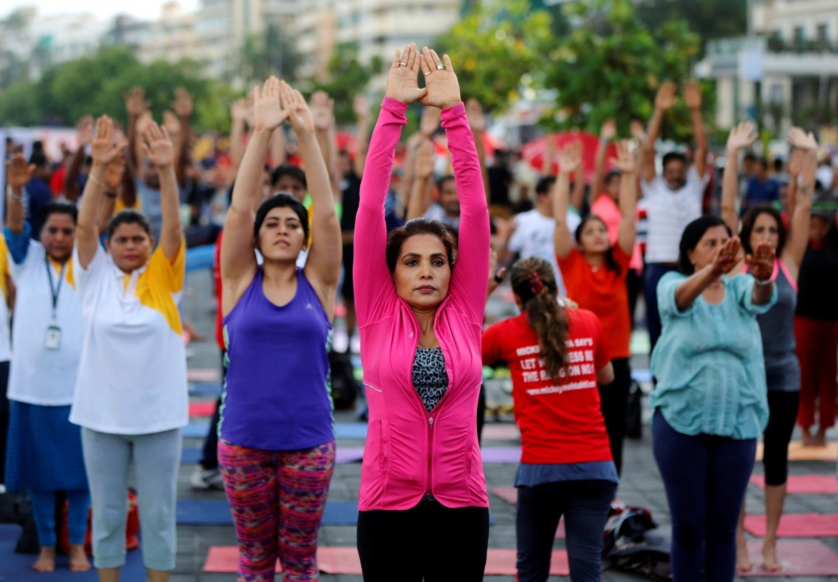 Participants perform yoga during World Yoga Day on a seafront promenade in Mumbai, India, June 21, 2016.