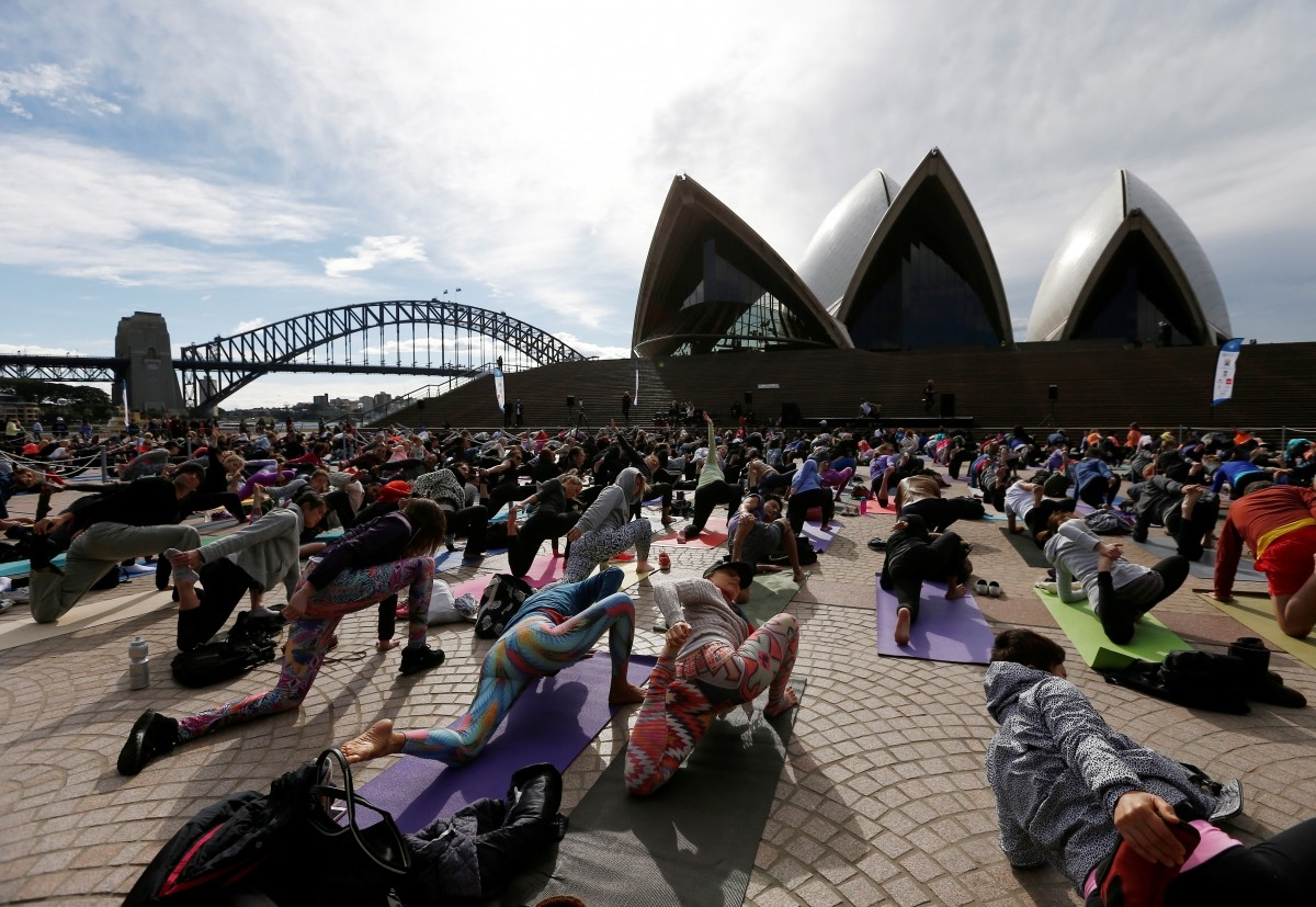 Hundreds participate in a mass yoga event in front of the Sydney Opera House on World Yoga Day in Sydney, Australia, June 21, 2016.