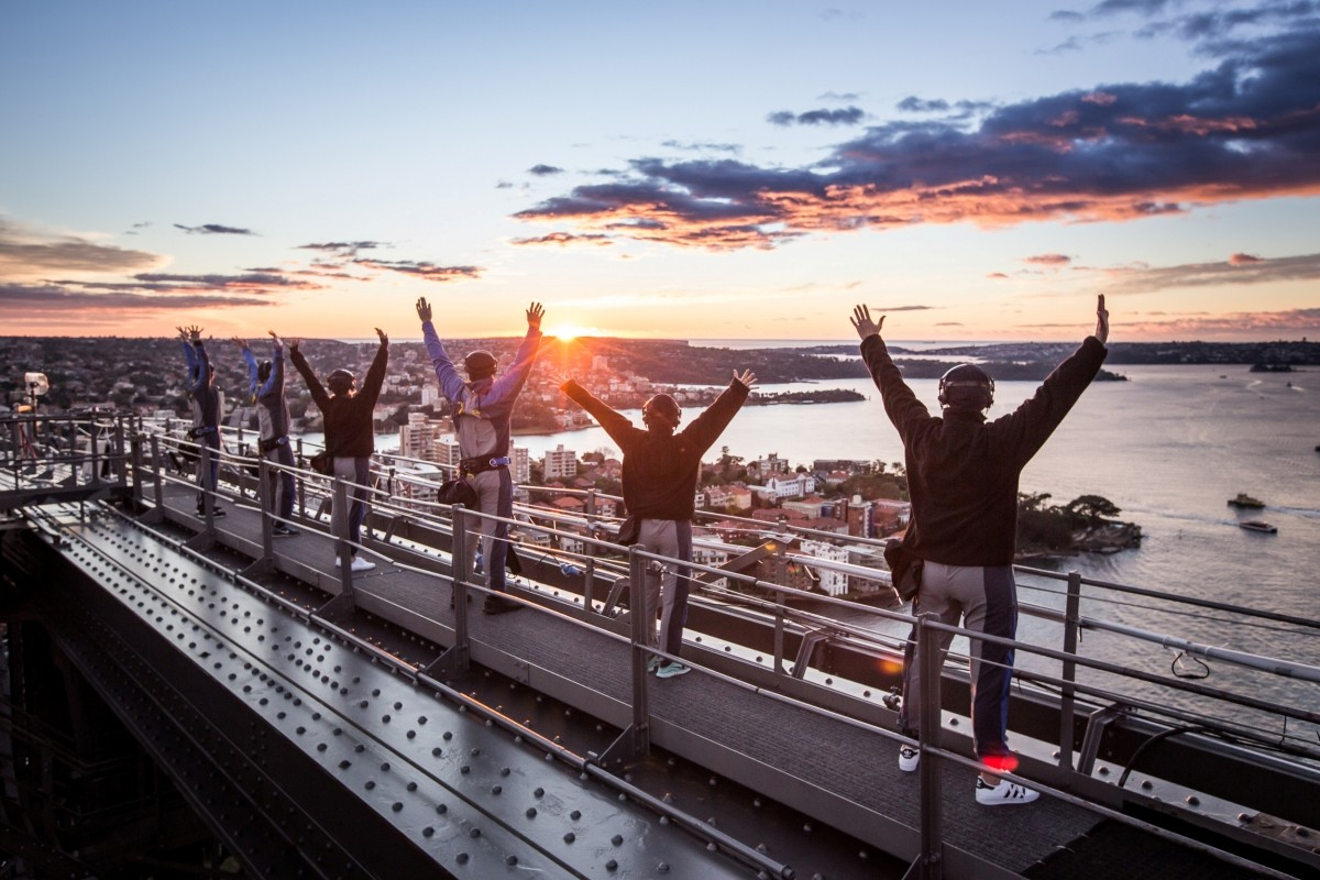 Yoga practitioners mark World Yoga Day for the first time on top of the Sydney Harbour Bridge at sunrise, June 21, 2016.