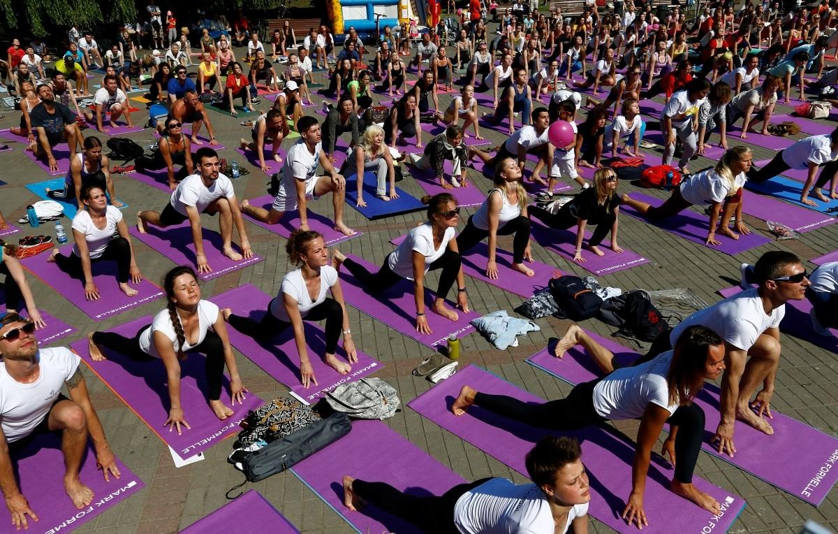People do yoga during International Yoga Day in Minsk, Belarus June 19, 2016.