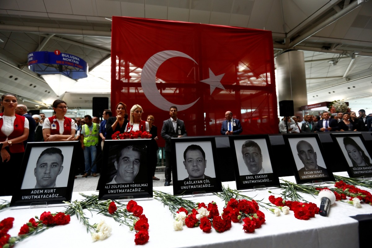 Airport employees attend a ceremony for their friends, who were killed in Tuesday's attack at the airport, at the international departure terminal of Ataturk airport in Istanbul, Turkey, June 30, 2016.