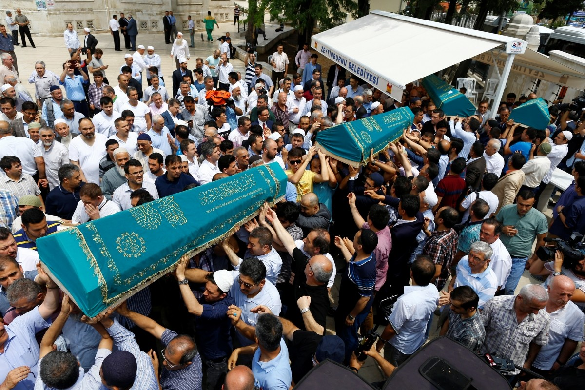 Relatives of four victims, who were members of the Amiri family who were killed in Tuesday's attack at the Istanbul airport, carry their coffins during their funeral ceremony in Istanbul, Turkey, June 30, 2016.