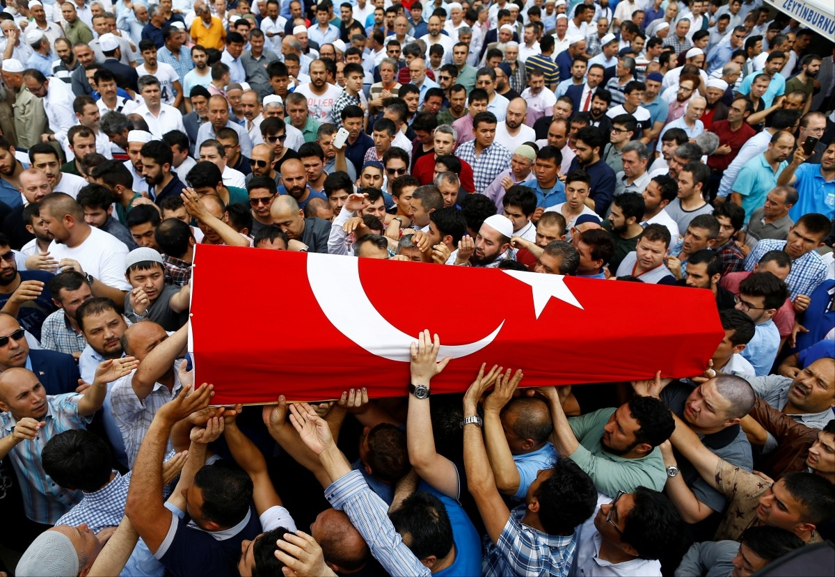 Friends and relatives of Habibullah Sefer, who was killed in Tuesday's attack at Istanbul airport, carry his flag-draped coffin during his funeral ceremony in Istanbul, Turkey, June 30, 2016.