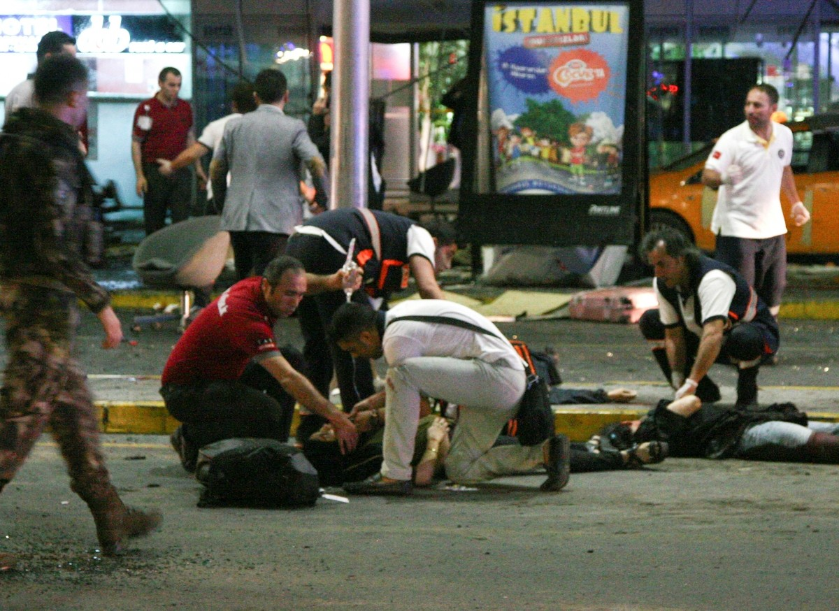 Paramedics attend to casualties injured outside Turkey's largest airport, Istanbul Ataturk, Turkey, following an attack, June 28, 2016.
