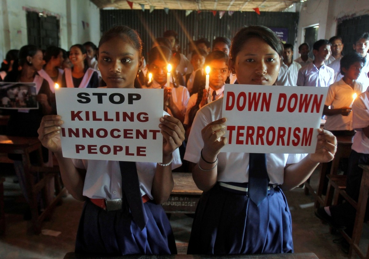 School children hold candles and placards as they pray during a vigil to show solidarity with the victims of the attack at Turkey's largest airport, Istanbul Ataturk, in Agartala, India, June 29, 2016.