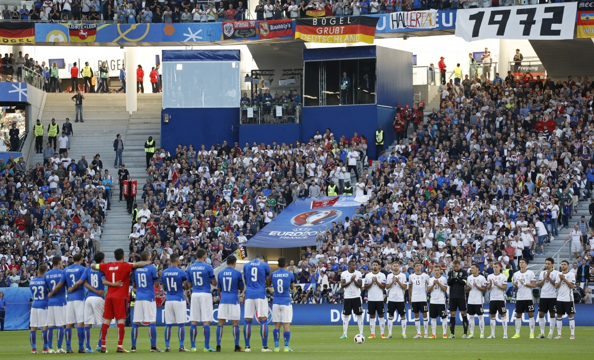 Football Soccer - Germany v Italy - EURO 2016 - Quarter Final - Stade de Bordeaux, Bordeaux, France - 2/7/16 Players line up during a minutes applause in tribute to the victims of the terrorist attack in Dhaka, Bangladesh before the match