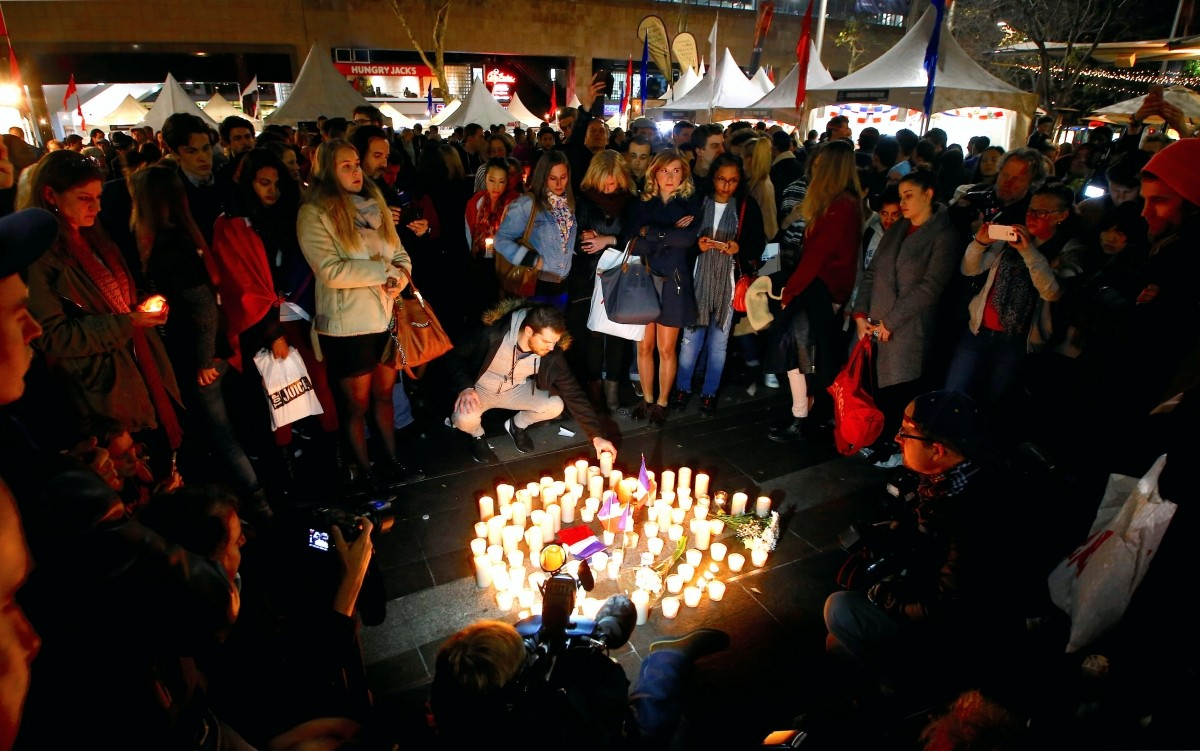 Members of the Australian French community place candles during a vigil in central Sydney, Australia, July 15, 2016.