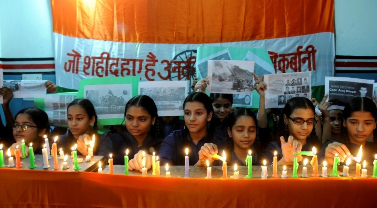 School students pay tribute to Kargil war martyrs on Kargil Vijay Diwas in Amritsar.