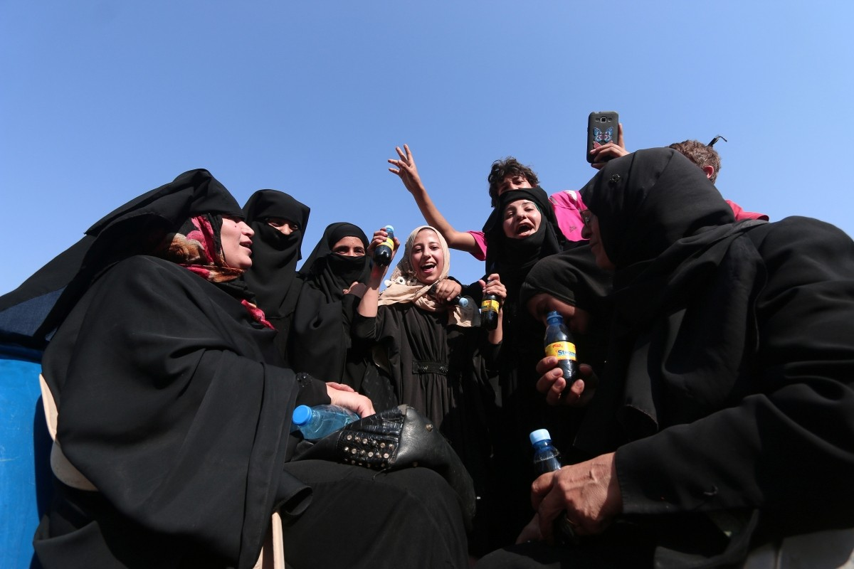 Civilians react after they were evacuated by the Syria Democratic Forces (SDF) fighters from an Islamic State-controlled neighbourhood of Manbij, in Aleppo Governorate, Syria, August 12, 2016. The SDF has said Islamic State was using civilians as human shields.