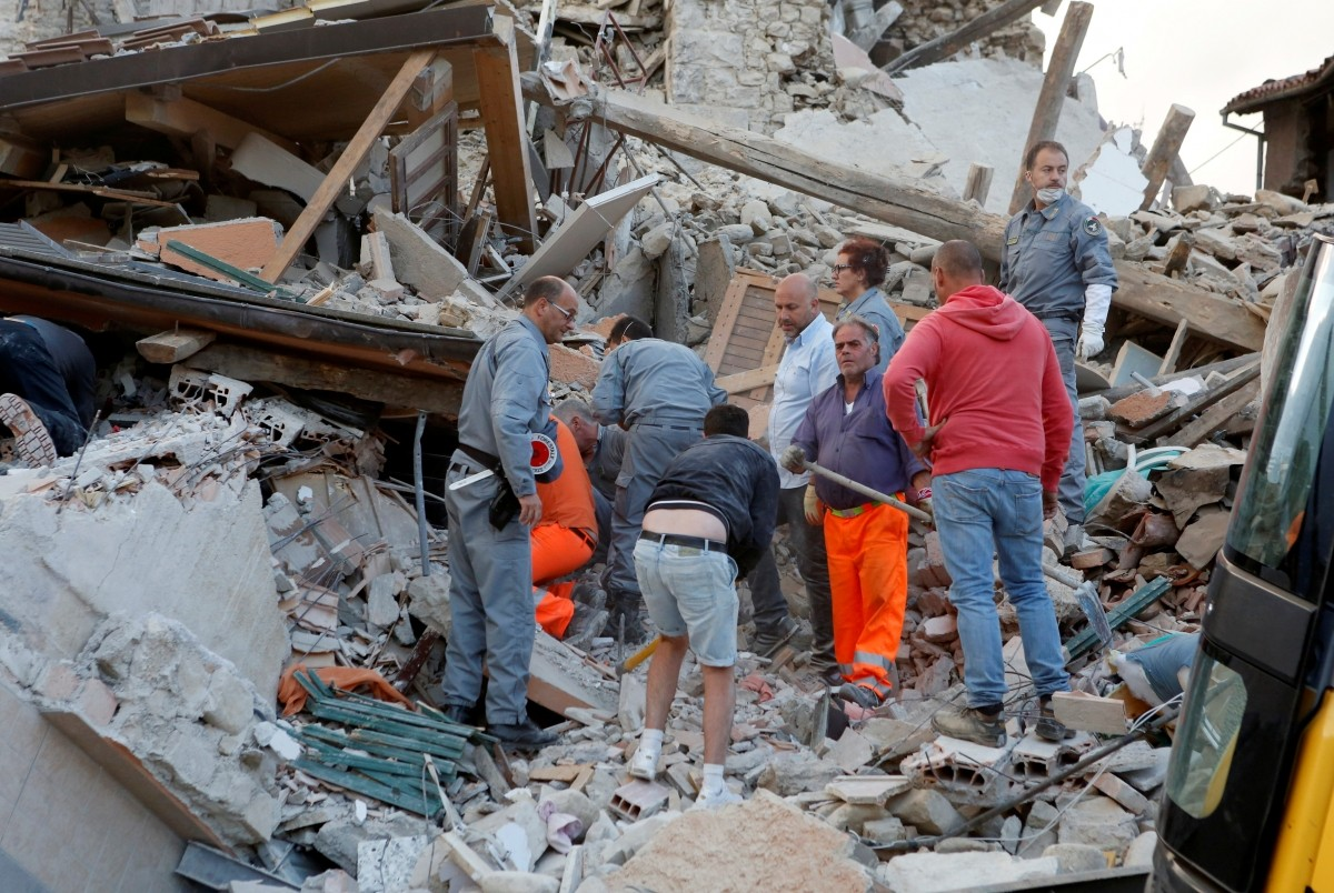 Rescuers works after a quake hit Amatrice, central Italy, August 24, 2016.