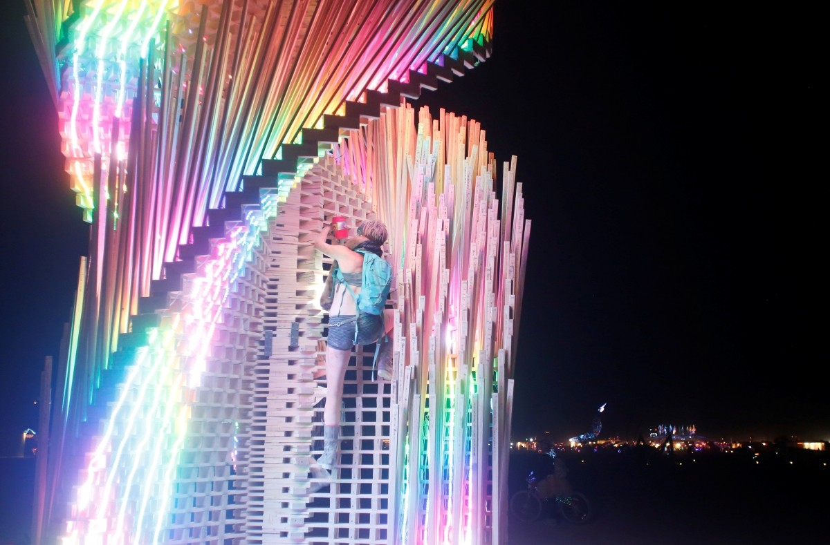 A participant climbs the art installation Tangential Dreams as approximately 70,000 people from all over the world gather for the 30th annual Burning Man arts and music festival in the Black Rock Desert of Nevada, U.S. August 31, 2016.