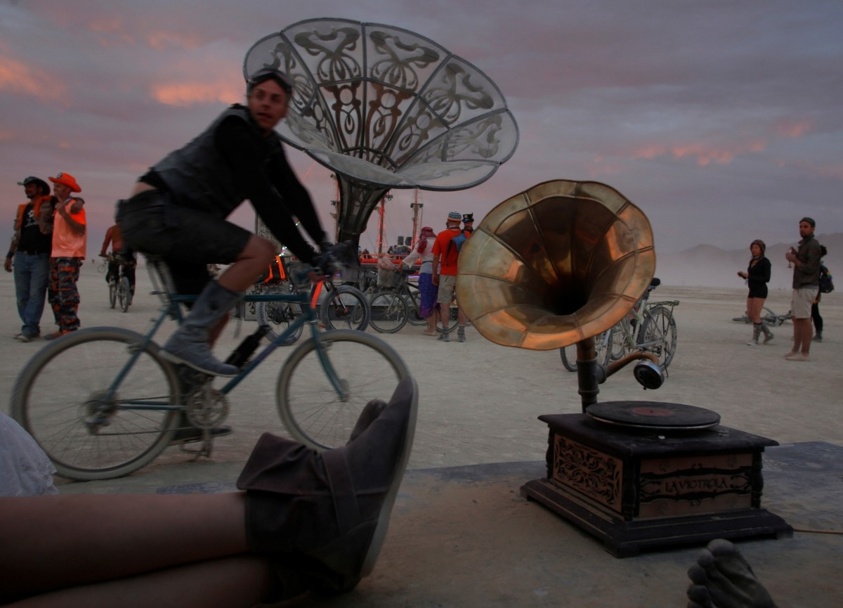 Participants explore the art installation La Victrola as approximately 70,000 people from all over the world gather for the 30th annual Burning Man arts and music festival in the Black Rock Desert of Nevada, U.S. September 1, 2016.