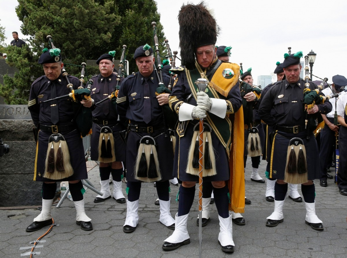 Members of the New York Police Department's (NYPD) Emerald Society Pipe & Drum Band hold a moment of silence to mark the 15th anniversary of the 9/11 attacks in New York City, U.S., September 9, 2016.