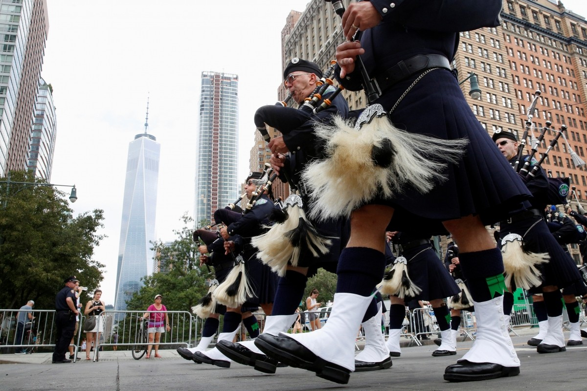 Members of the Seattle Police Pipes and Drums march during a procession through lower Manhattan to the New York Police Department's (NYPD) memorial to mark the 15th anniversary of the 9/11 attacks in New York City, U.S., September 9, 2016.
