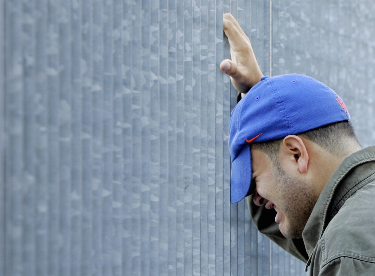 A man grieves outside the World Trade Center site in New York September 11, 2006.
