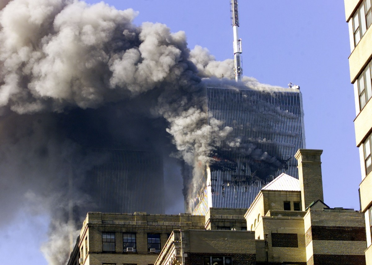 The two towers of the World Trade Center in New York City burn September 11, 2001.
