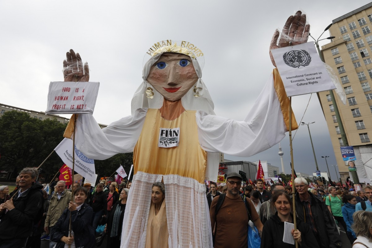 Consumer rights activists take part in a march to protest against the Transatlantic Trade and Investment Partnership (TTIP) and Comprehensive Economic and Trade Agreement (CETA) in Berlin, Germany, September 17, 2016.
