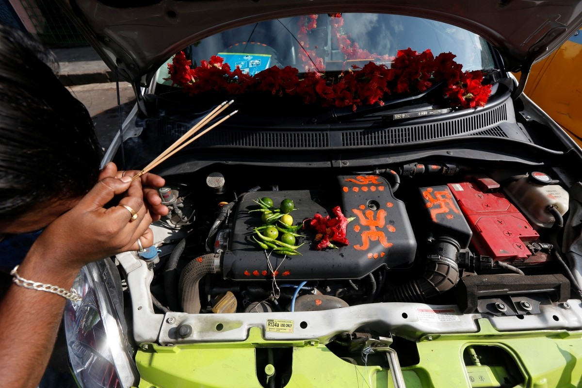 A taxi driver offers prayers to his car during the Vishwakarma Puja festival in Kolkata, India, September 17, 2016.