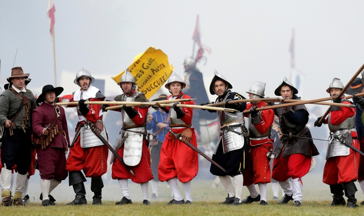 Participants wearing medieval costumes re-enact the 1620 battle of Bila Hora between Bohemian Estates and Austrian Imperial with Catholic forces in Prague, Czech Republic September 18, 2016.