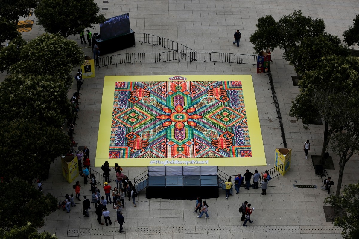 26,896 cans of Play-Doh are pictured during a Guinness World Records attempt for the biggest mosaic, inspired by indigenous Huichol art, as part of a promotional event celebrating the product's 60th anniversary, in Mexico City, Mexico September 23, 2016.