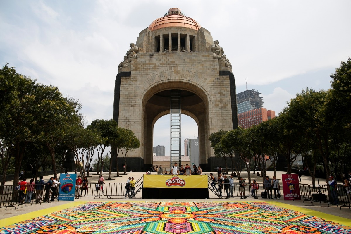 26,896 cans of Play-Doh, a Guinness World Records attempt for the biggest mosaic, inspired by indigenous Huichol art, is seen in front of the Monument of the Revolution during a promotional event celebrating the product's 60th anniversary, in Mexico City, Mexico September 23, 2016