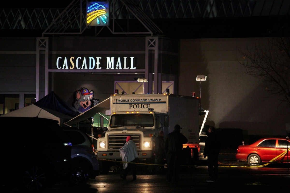 Authorities are pictured at the Cascade Mall following reports of an active shooter in Burlington, Washington.