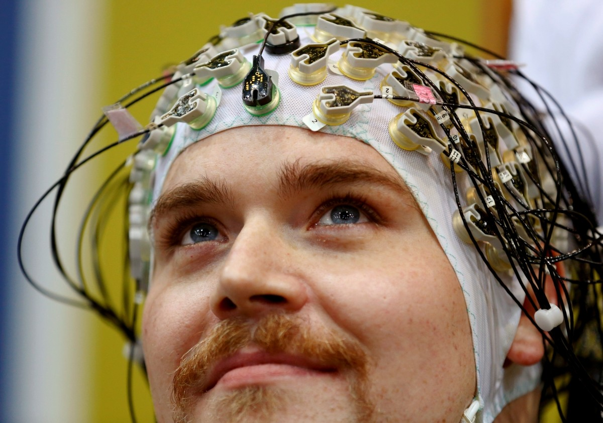 Sebastian Reul of Germany looks up as he competes during the Brain-Computer Interface Race (BCI) at the Cybathlon Championships in Kloten, Switzerland October 8, 2016.