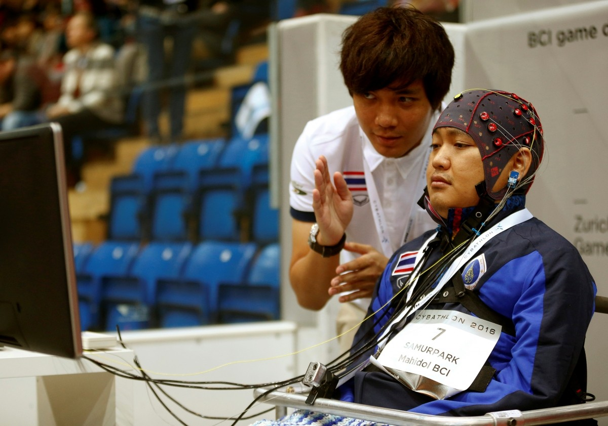 Supawat Samurpark (R) of Thailand competes during the Brain-Computer Interface Race (BCI) at the Cybathlon Championships in Kloten, Switzerland October 8, 2016