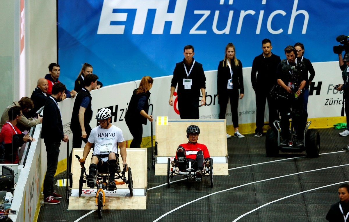 Hanno Voigt (L) of Germany and Julien Jouffroy of Switzerland start during the Functional Electrical Stimulation Bike Race at the Cybathlon Championships in Kloten, Switzerland October 8, 2016.