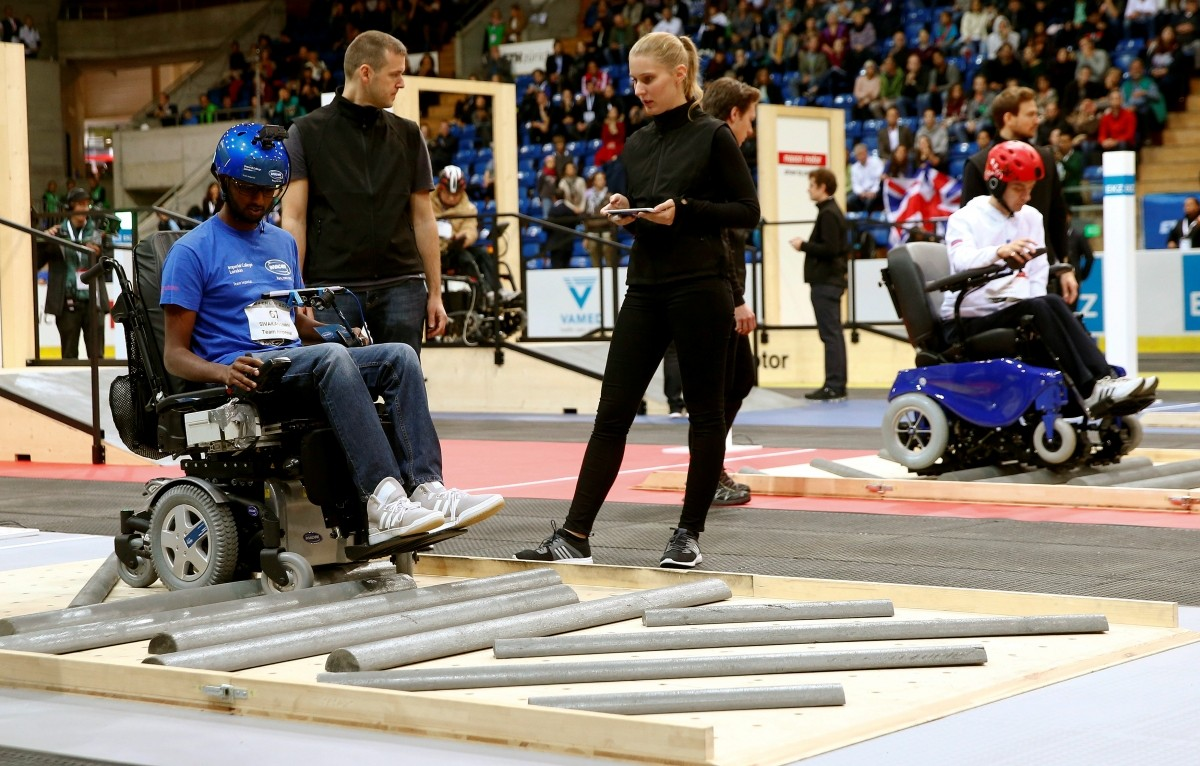 Britain's Sivashankar Sivakanthan and Yuri Larin (R) of Russia compete during the Powered Wheelchair Race at the Cybathlon Championships in Kloten, Switzerland October 8, 2016.