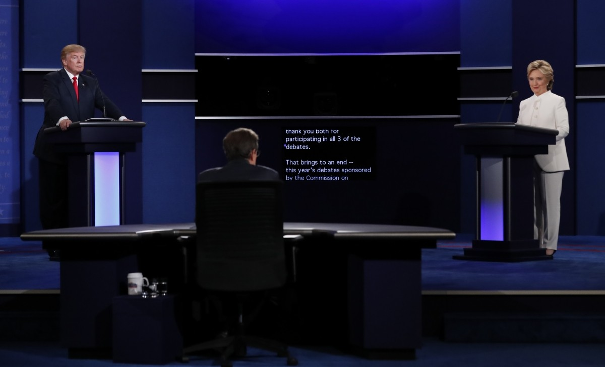 A teleprompter in front of moderator by Chris Wallace (C) marks the end of the third and final 2016 presidential campaign debate between Republican U.S. presidential nominee Donald Trump and Democratic U.S. presidential nominee Hillary Clinton at UNLV in Las Vegas, Nevada, U.S., October 19, 2016.