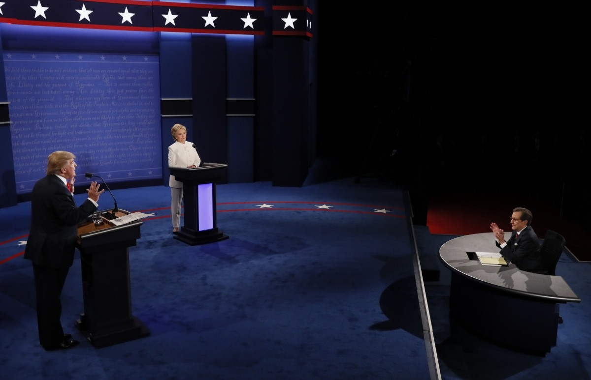 Republican U.S. presidential nominee Donald Trump speaks as Democratic U.S. presidential nominee Hillary Clinton listens during their third and final 2016 presidential campaign debate at UNLV in Las Vegas, Nevada, U.S., October 19, 2016.
