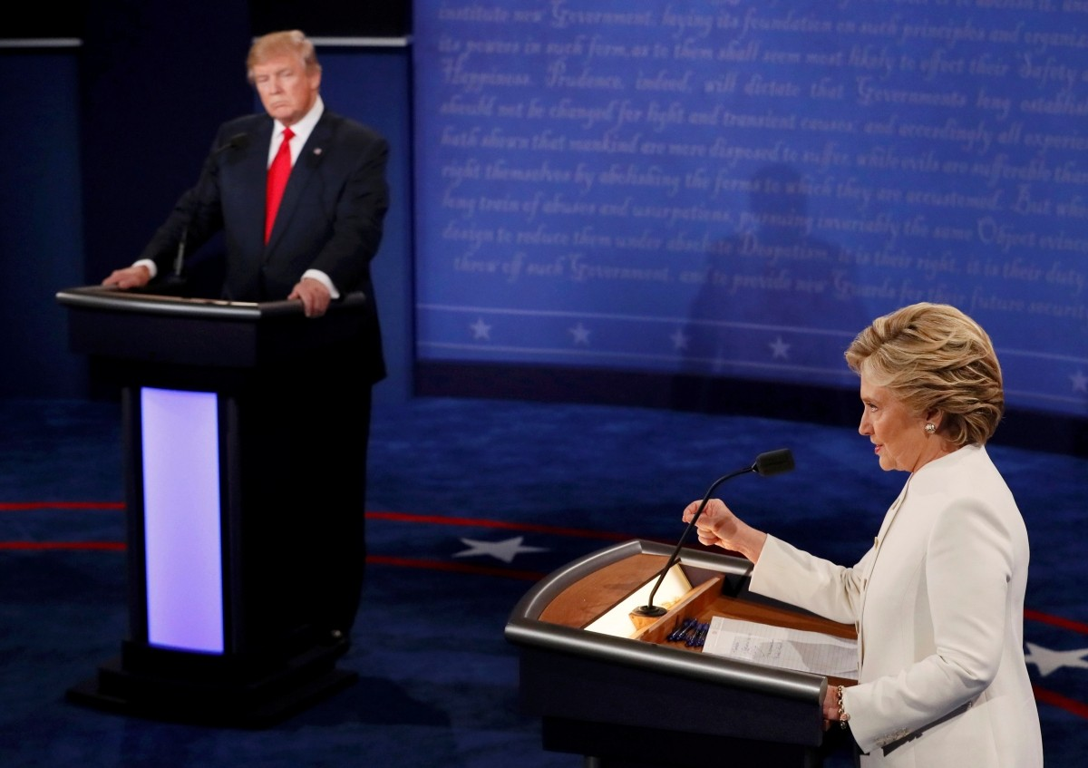 Democratic U.S. presidential nominee Hillary Clinton speaks as Donald Trump looks on during their third and final 2016 presidential campaign debate at UNLV in Las Vegas, Nevada, U.S., October 19, 2016.