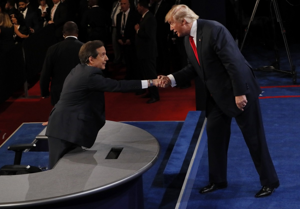 Republican U.S. presidential nominee Donald Trump shakes the hand of debate moderator Chris Wallace after the third and final 2016 presidential campaign debate at UNLV in Las Vegas, Nevada, U.S., October 19, 2016.