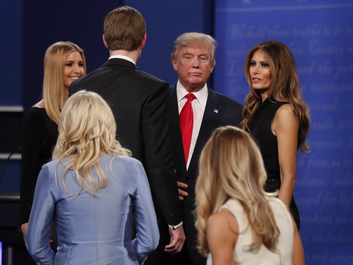 Republican U.S. presidential nominee Donald Trump, his daughter Ivanka (L), son Eric and wife Melania speak after the third and final 2016 presidential campaign debate at UNLV in Las Vegas, Nevada, U.S., October 19, 2016.