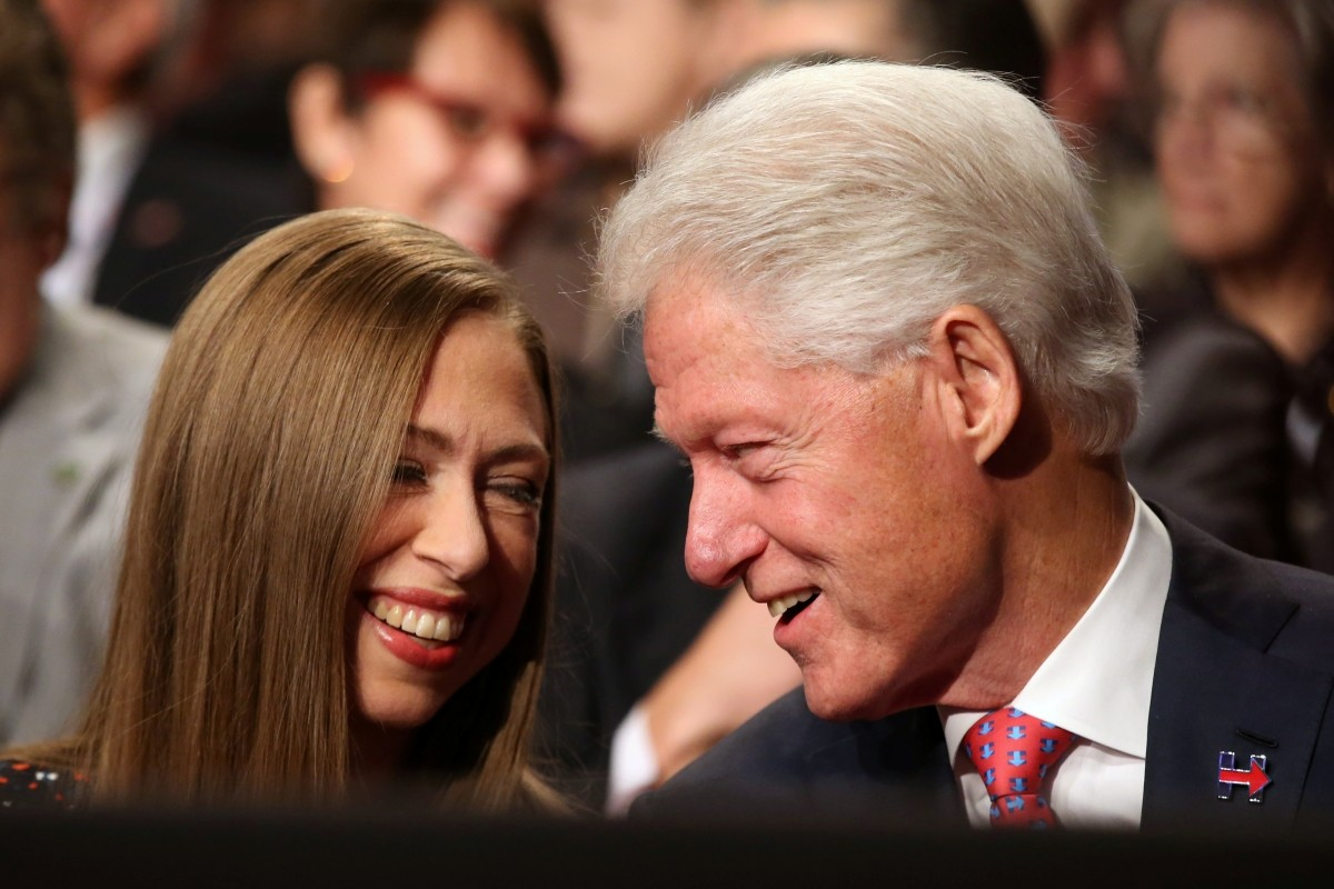 Former U.S. President Bill Clinton (R) talks with his daughter Chelsea Clinton prior to the third and final 2016 presidential campaign debate between Republican U.S. presidential nominee Donald Trump and Democratic U.S. presidential nominee Hillary Clinton at UNLV in Las Vegas, Nevada, U.S., October 19, 2016.