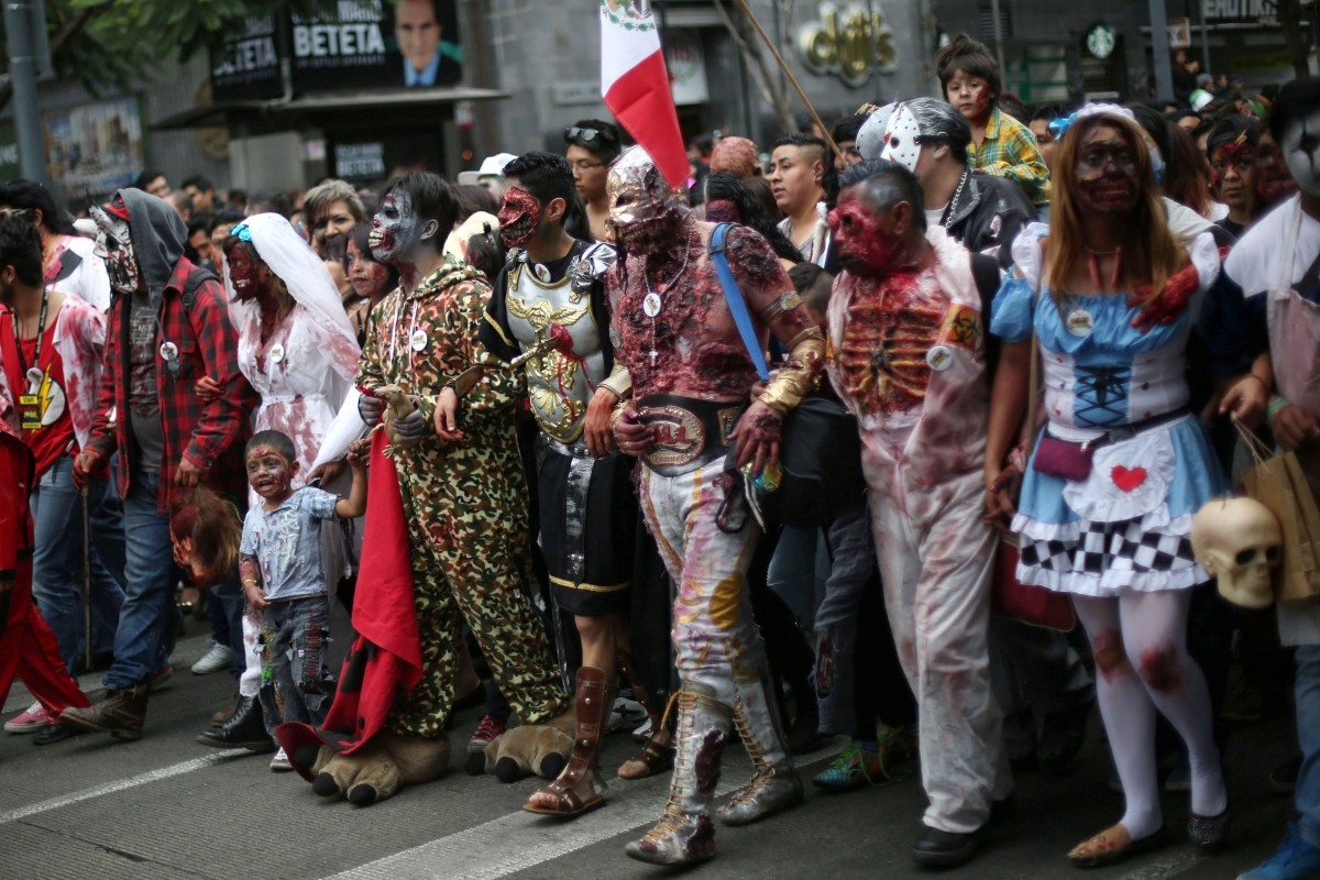 People dressed as zombies participate in a Zombie Walk procession in Mexico City, Mexico, October 22, 2016.