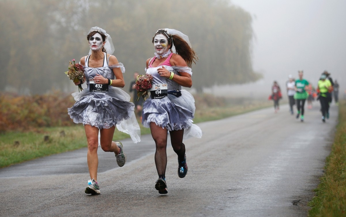 Participants take part in a Trick or Treat halloween fun run in Richmond Park, London, Britain. October 30, 2016.