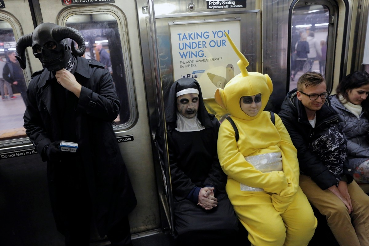 People in costume ride the subway on Halloween in Manhattan, New York, U.S., October 31, 2016.