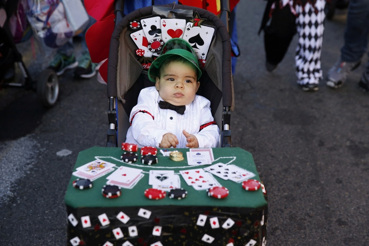 A young child takes part in the Hoboken Ragamuffin Parade to celebrate Halloween in Hoboken, New Jersey U.S.,October 31, 2016.