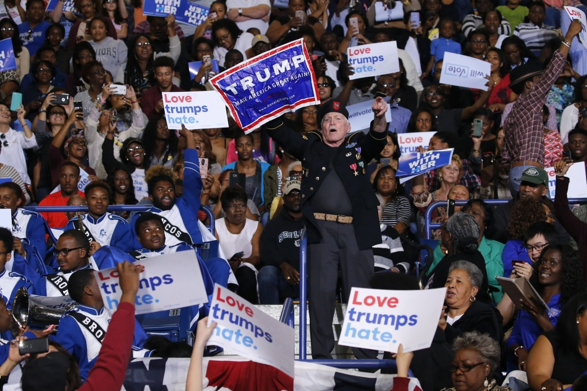A Donald Trump supporter disrupts remarks by President Barack Obama at a Hillary for America campaign event at the Fayetteville State University in Fayetteville, North Carolina. November 4, 2016.