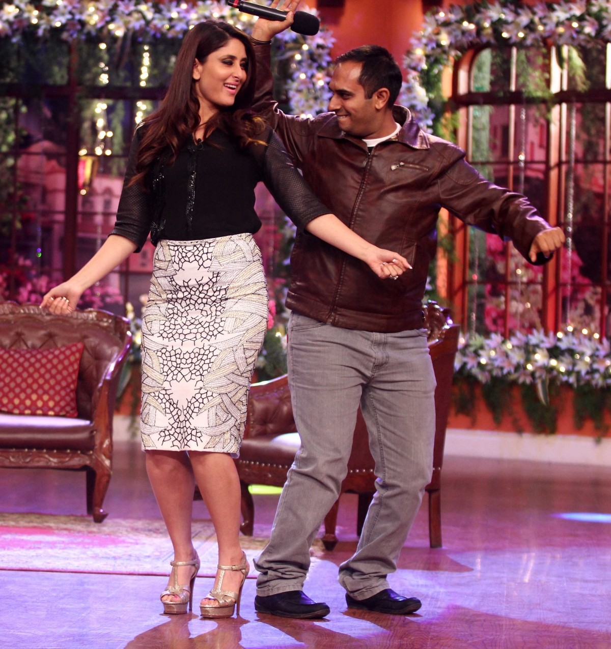 Kareena dances with one of her many fans on the show