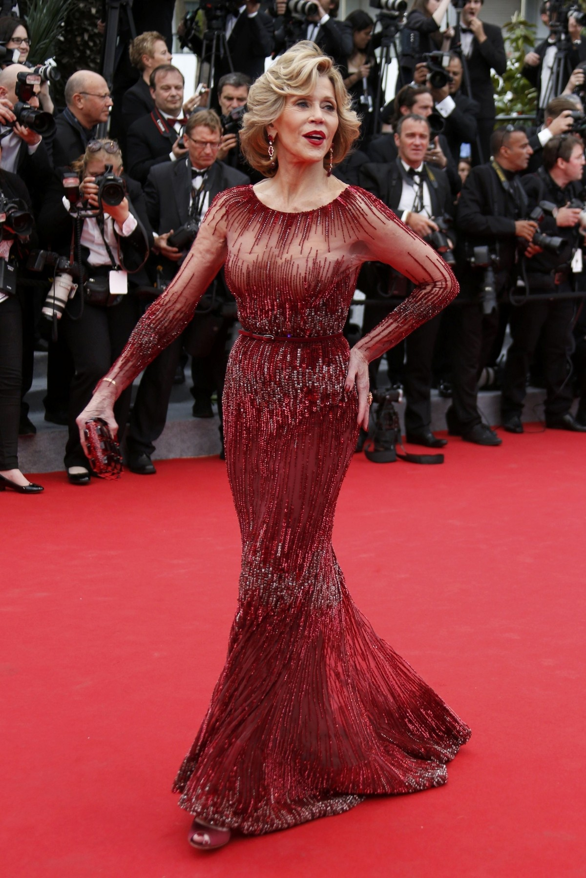 Actress Jane Fonda poses on the red carpet as she arrives for the opening ceremony of the 67th Cannes Film Festival in Cannes